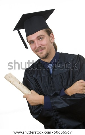 Young man with graduation cap and gown - stock photo