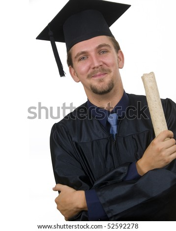Young man with graduation cap and gown and diploma - stock photo