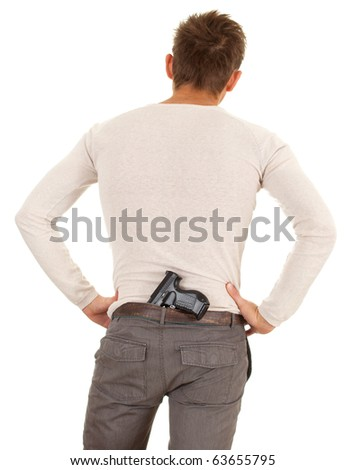 young man with gun isolated on the white background - stock photo