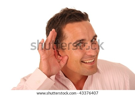 Young man with hand cupped to ear