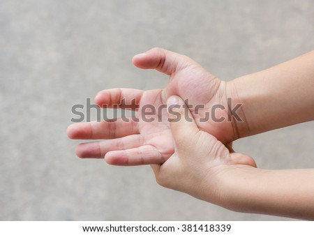 Young man with hand pain - pain concept - stock photo