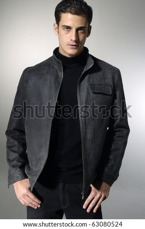 young man with hands folded isolated - stock photo