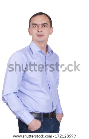 Young man with hands in pocket, isolated on white background