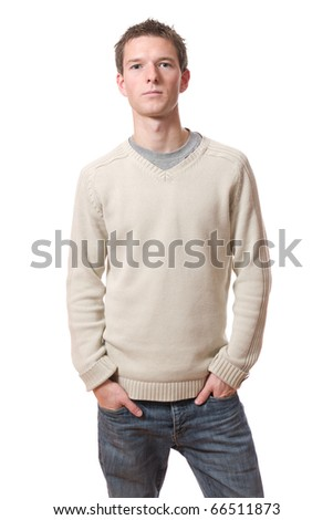 young man with hands in pockets isolated over white background