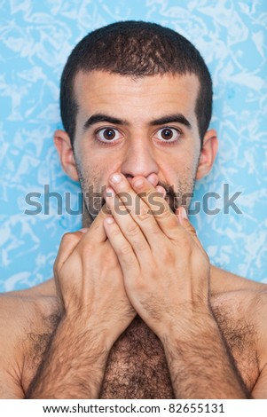 Young Man with Hands on Mouth - stock photo