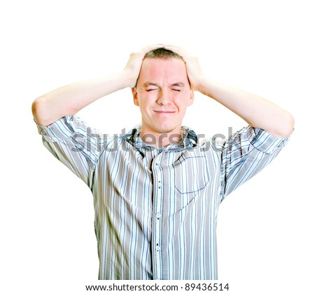 young man with hands on the head - stock photo