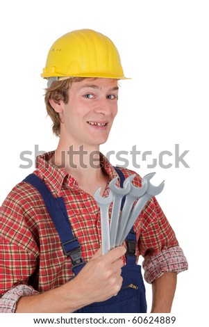 Young man with hardhat holding some wrenches - isolated on white - stock photo
