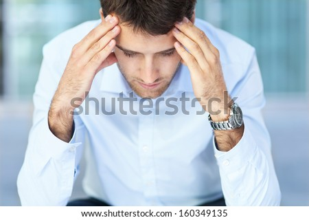 Young man with headache - stock photo