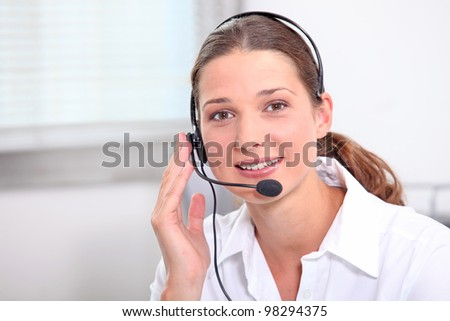 Young man with headphones and microphone - stock photo