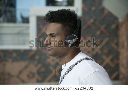 young man with headphones listening to music 3871