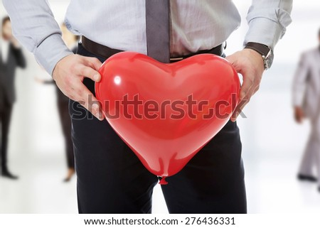 Young man with heart balloon. - stock photo