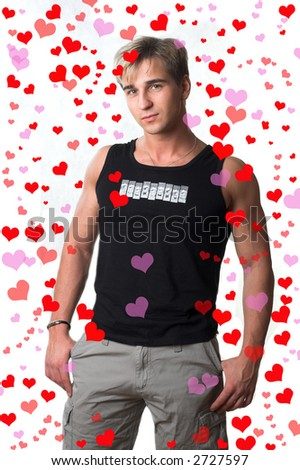 Young man with hearts - stock photo