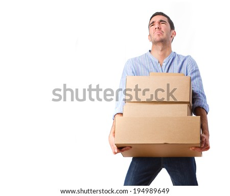 young man with heavy boxes