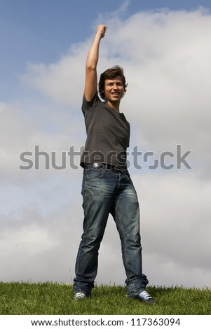 Young man with his arm up