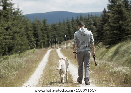 Young man with his dog - stock photo