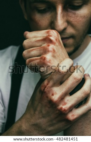 Young man with his fists with blood