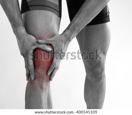 Young man with knee pain .