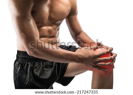 Young man with knee pain,isolated on white background with clipping path - stock photo