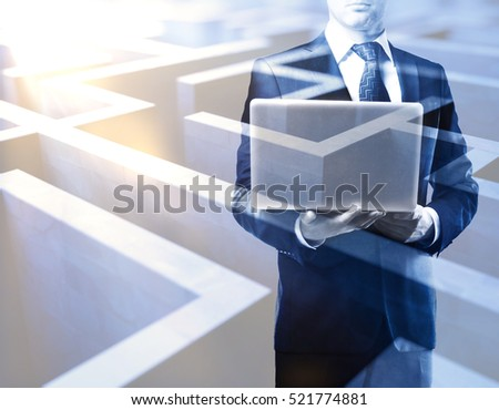 Young man with laptop on abstract maze background. Double exposure. Business challenge concept