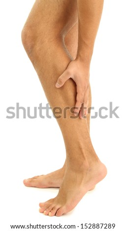 Young man with leg pain, isolated on white - stock photo