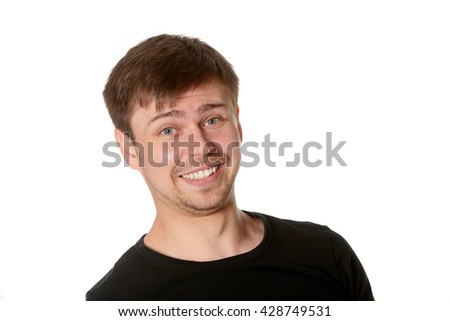 Young man with manic insincere smile, on white - stock photo