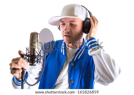 Young man with microphone and headphones over white - stock photo