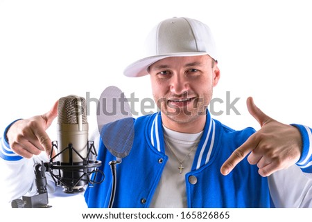 Young man with microphone and over white background - stock photo