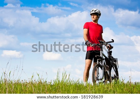 Young man with mountain bike. Summer vacation