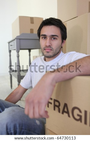 Young man with moving boxes