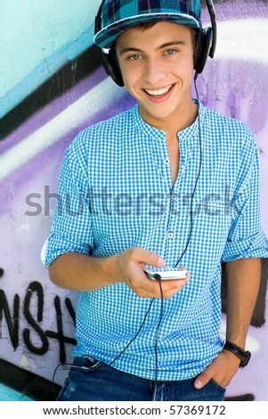 Young man with mp3 player - stock photo