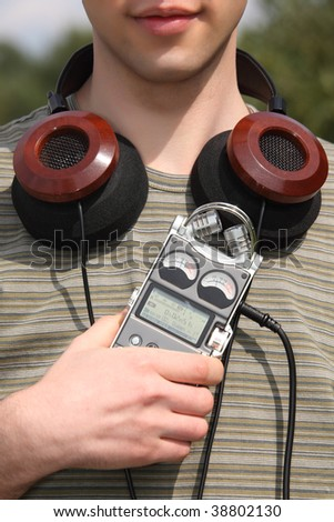 Young man with music player and headphones - stock photo