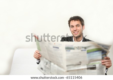 young man with newspaper - stock photo