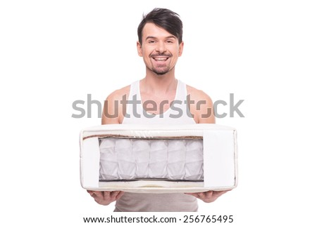 Young man with nice, quality mattress that supported you to sleep well all night. - stock photo