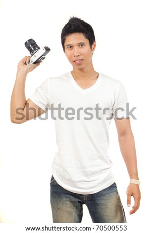 young man with old camera - stock photo