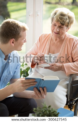 Young man with older woman spending time at home