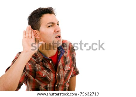 young man with open hand, hearing something - stock photo
