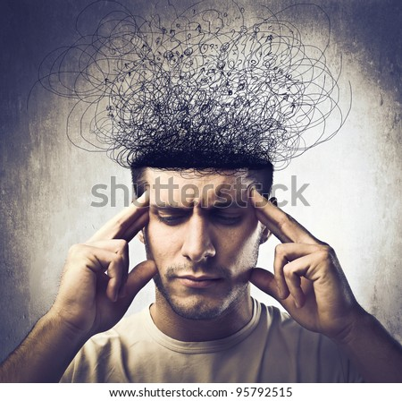 Young man with pensive expression and brain melting into lines - stock photo