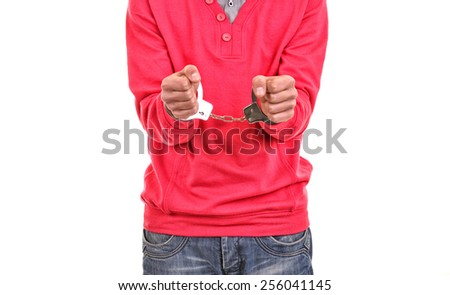 young man with pink blouse handcuffed - stock photo