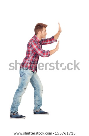 Young man with plaid shirt pushing isolated on white background - stock photo
