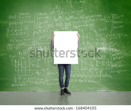 young man with poster in room with drawing  plan on wall - stock photo