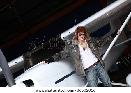 Young man with private airplane, a lifestyle image - stock photo