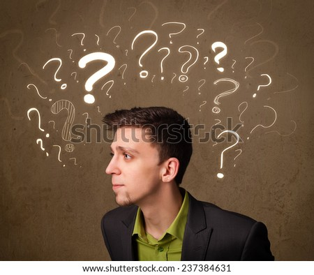 Young man with question mark symbols around his head