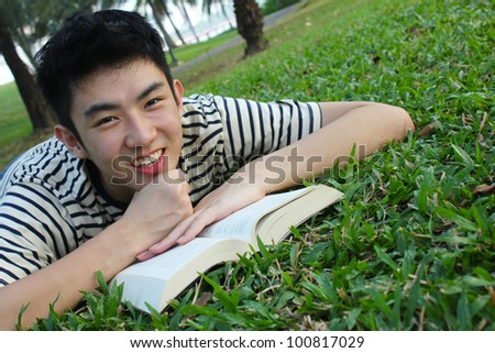 Young man with reading the book - stock photo