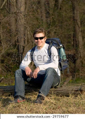 Young man with ? rucksack and sun glasses