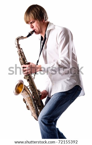 Young man with saxophone over white background - stock photo
