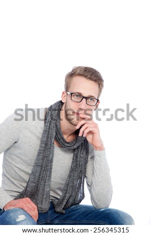 young man with scarf around his neck on white background - stock photo
