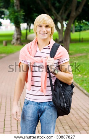 young man with shoulder bag - stock photo
