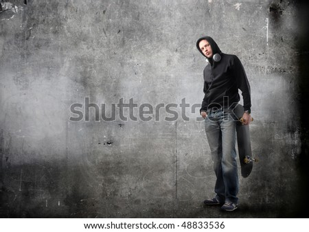 Young man with skateboard - stock photo