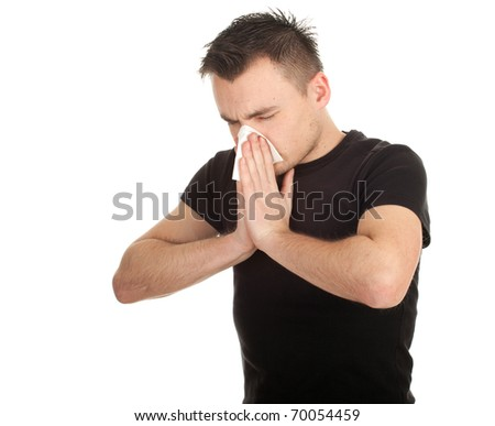 young man with snotty, runny nose and handkerchief - stock photo