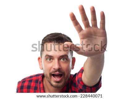 Young man with squares shirt over white background. Stopping someone
